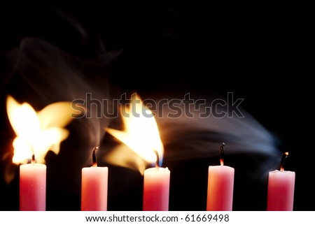 Five pink candles blowing out - stock photo