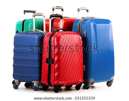 Five plastic suitcases isolated on white. - stock photo