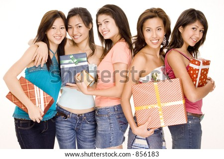 Five pretty asian women holding gifts and presents