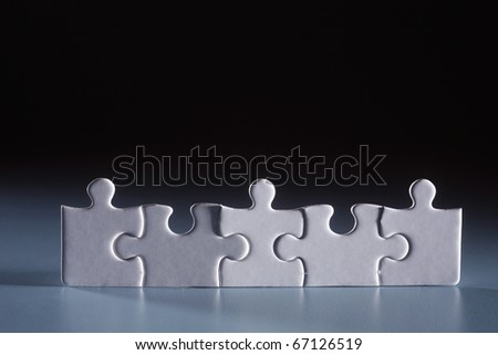 Five puzzle pieces arranged together. - stock photo
