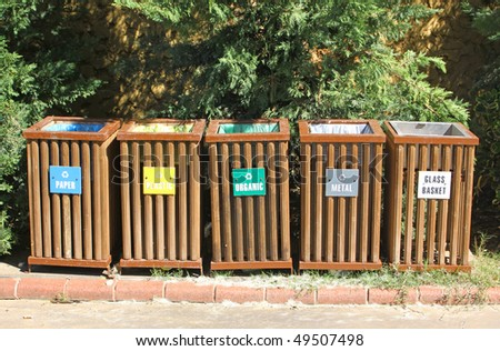 Five recycle bins for waste segregation - stock photo