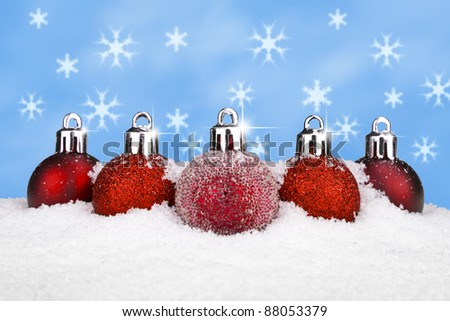 Five red baubles in the snow. Christmas concept. - stock photo