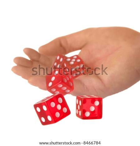 Five red dice being thrown from a hand, shallow DOF. - stock photo