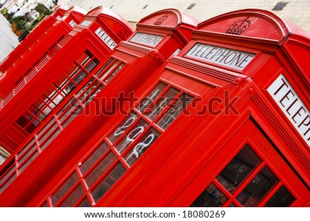 Five red phone boxes, angled composition - stock photo