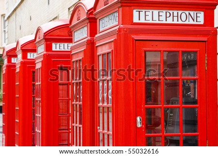 Five red phone boxes, grunge toned - stock photo