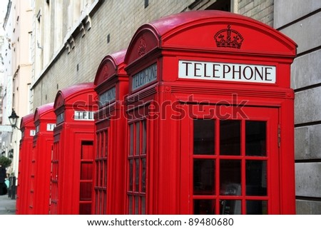 Five red telephone boxes  in London - stock photo