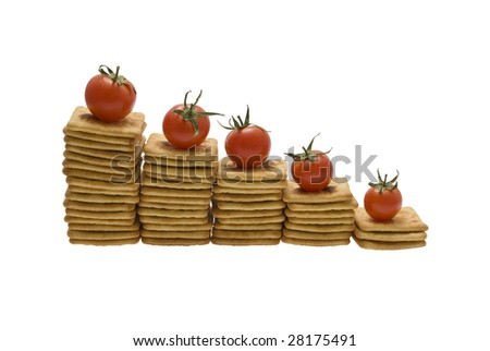 Five red tomatoes lying on steps made of dry biscuits - stock photo