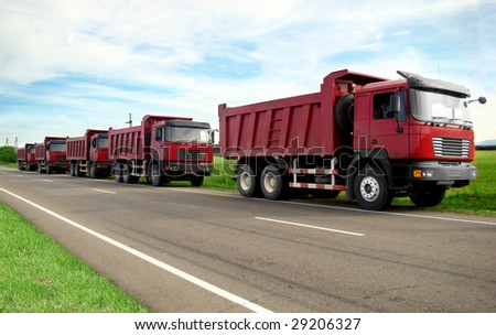 five red truck on a road
