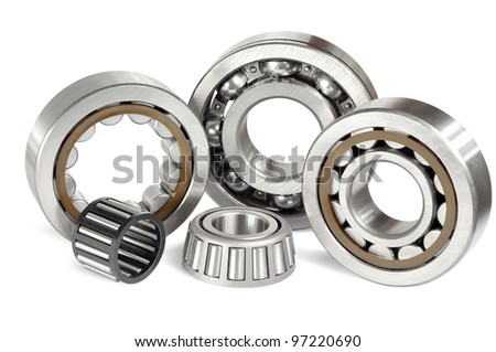 Five roller and ball bearings on a white background