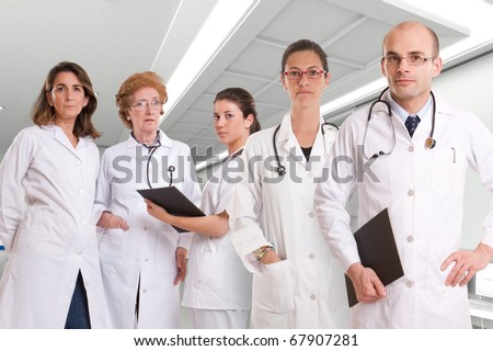 Five serious healthcare professionals in a hospital interior
