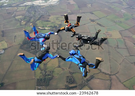 Five skydivers in freefall - stock photo