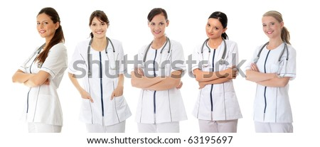 Five smiling medical doctors or nurses. Isolated on white background