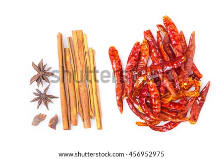 Five spices and dried chili peppers on white background - stock photo
