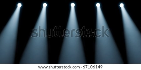 five spotlights on a black background - stock photo