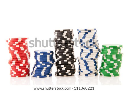Five stacks colorful poker chips isolated over white background - stock photo