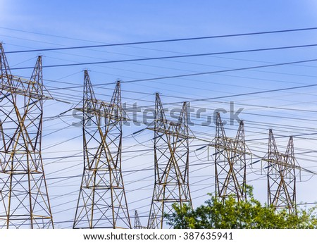 Five steel hydro towers support power cables carrying high voltage electricity from the generating plant in Niagara Falls Canada. - stock photo