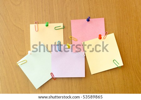 five sticker notes with pins and clip - stock photo