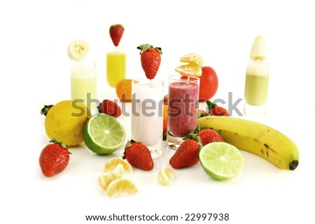 FIve strawberry smoothies and fresh fruits - stock photo