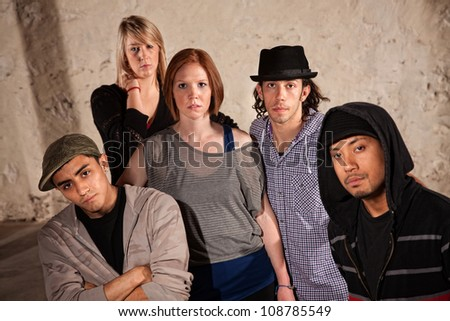 Five stylish hip hop dancers posing in urban setting - stock photo