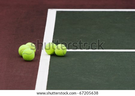 Five tennis balls on the court - stock photo