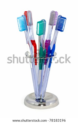 five toothbrushes in a metal holder - stock photo