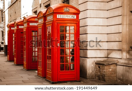 Five traditional old style red phone boxes in London, UK. Aged photo. - stock photo