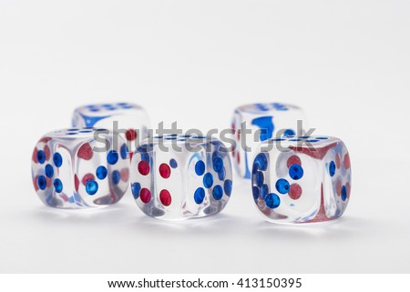 five transparent dice with red and blue dots on white background.