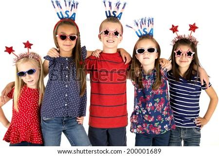 Five USA patriotic children arm in arm - stock photo