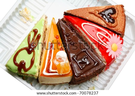 Five various pieces of cake on a plastic tray