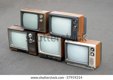 Five vintage TV sets - stock photo