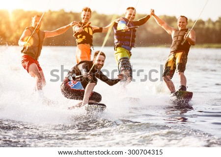 Five wake bord riders are having the fun - stock photo