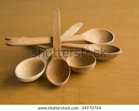 Five wooden spoons - stock photo