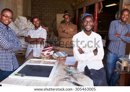 Five workers in a carpentry workshop, portrait, South Africa - stock photo