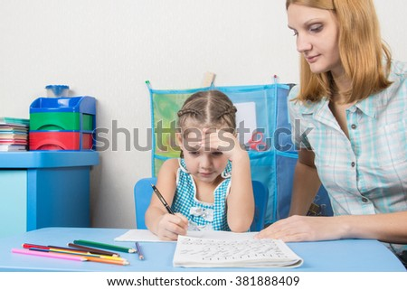 Five-year girl thought doing a spelling tutor - stock photo
