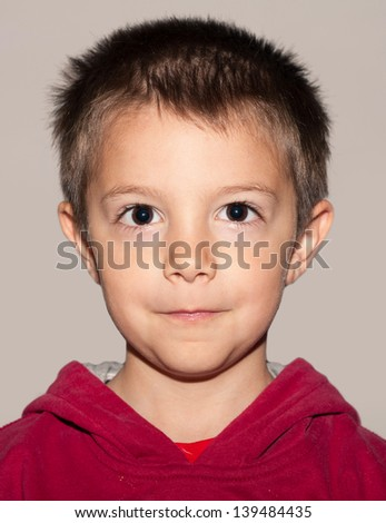 Five year kid passport photo, against neutral background. - stock photo