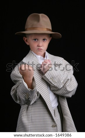 five year old boy playing dress-up is ready to fight - stock photo