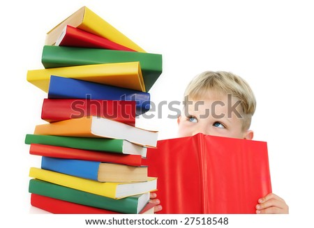 Five year old boy reading a book, with a stack of books next to him. Isolated on white. - stock photo