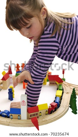 Five year old girl playing with wooden blocks - stock photo