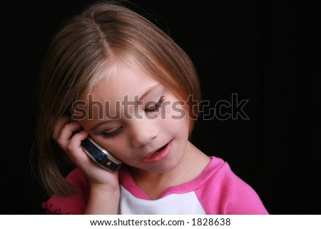 five year old girl talking on cell phone