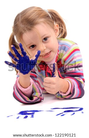 Five year old girl with hands painted - stock photo