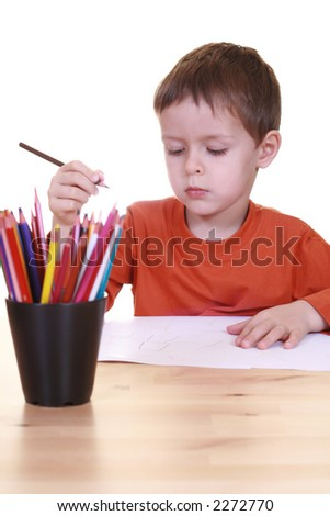 five years boy and his crayons isolated on white