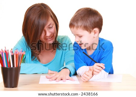 five years old boy and his mother drawing together isolated on white