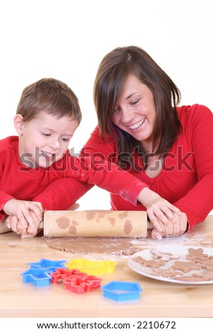five years old boy and his mother making delicious cookies isolated on white