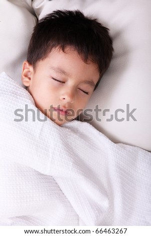 Five years old child sleeping with white blanket - stock photo