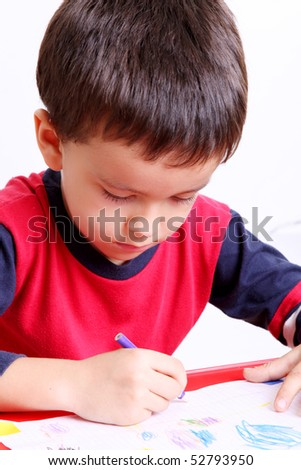 Five years old child writing, White background - stock photo