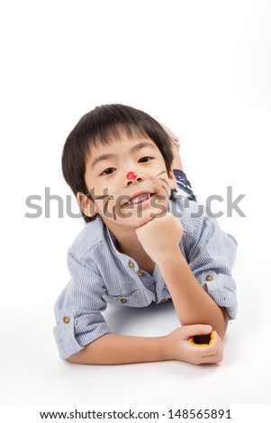 five years old lie down and prop up also smiling - stock photo