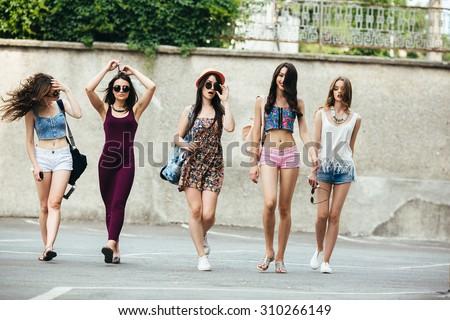 Five young beautiful girls having fun outdoors - stock photo