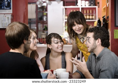 Five young friends in a coffee house