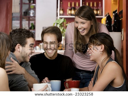 Five young friends in a coffee house - stock photo