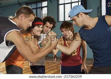 Five young men taking an oath - stock photo